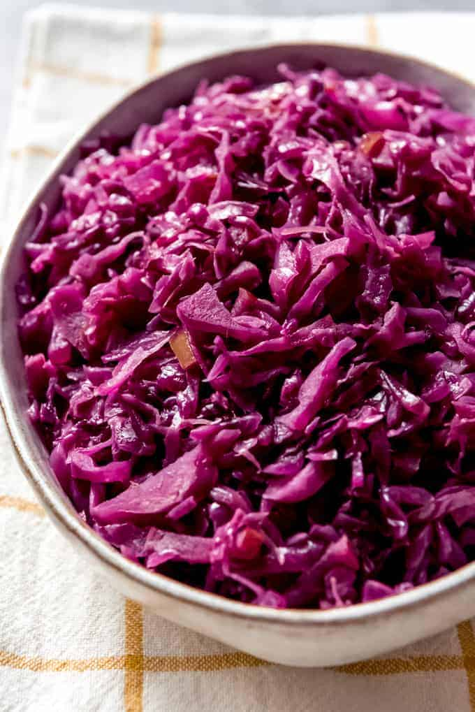 An image of a bowl of thinly sliced, braised red cabbage made with vinegar and apple cider the traditional German way.