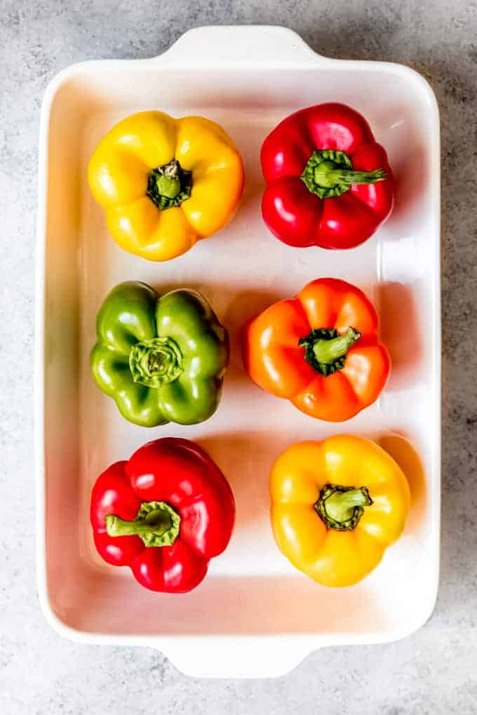 An image of colorful bell peppers in a baking dish.