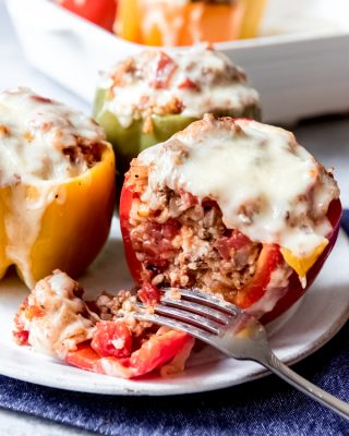 An image of a red stuffed bell pepper that is cut in half.