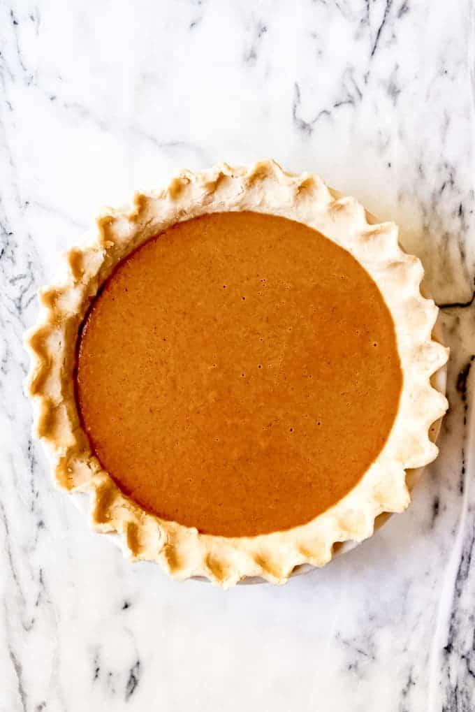 An image of an unbaked pumpkin pie.