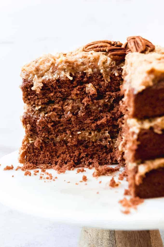 An image of a sliced three-layer German chocolate cake with homemade coconut pecan frosting.
