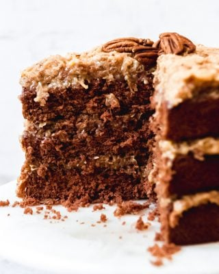 An image of a sliced, three-layer German chocolate cake with homemade coconut pecan frosting.