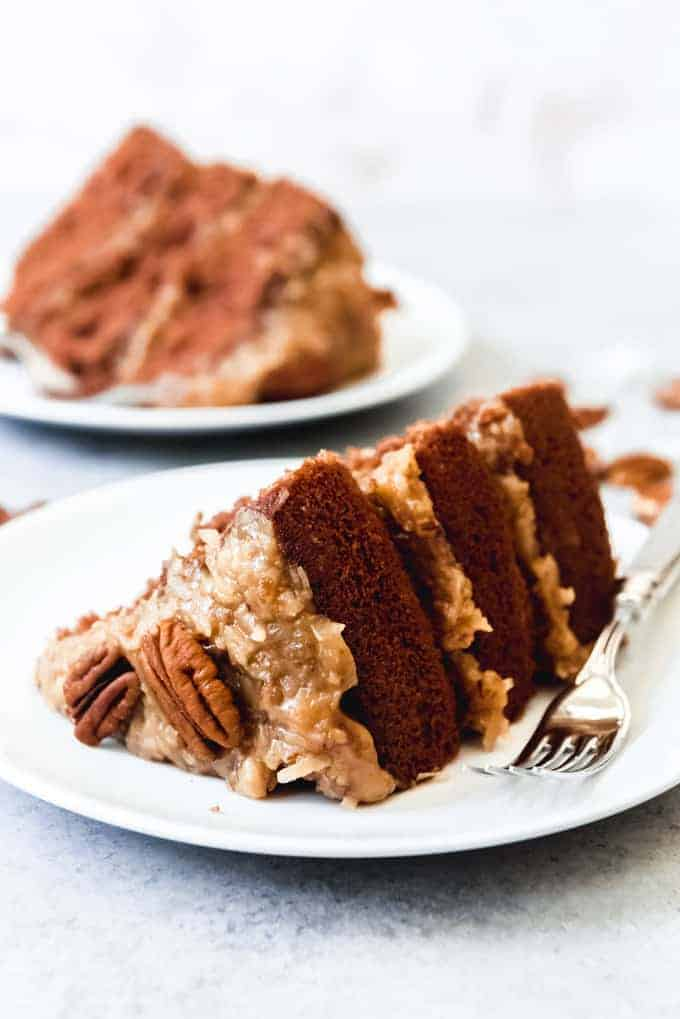 An image of a slice of homemade German Chocolate Cake on a white plate.