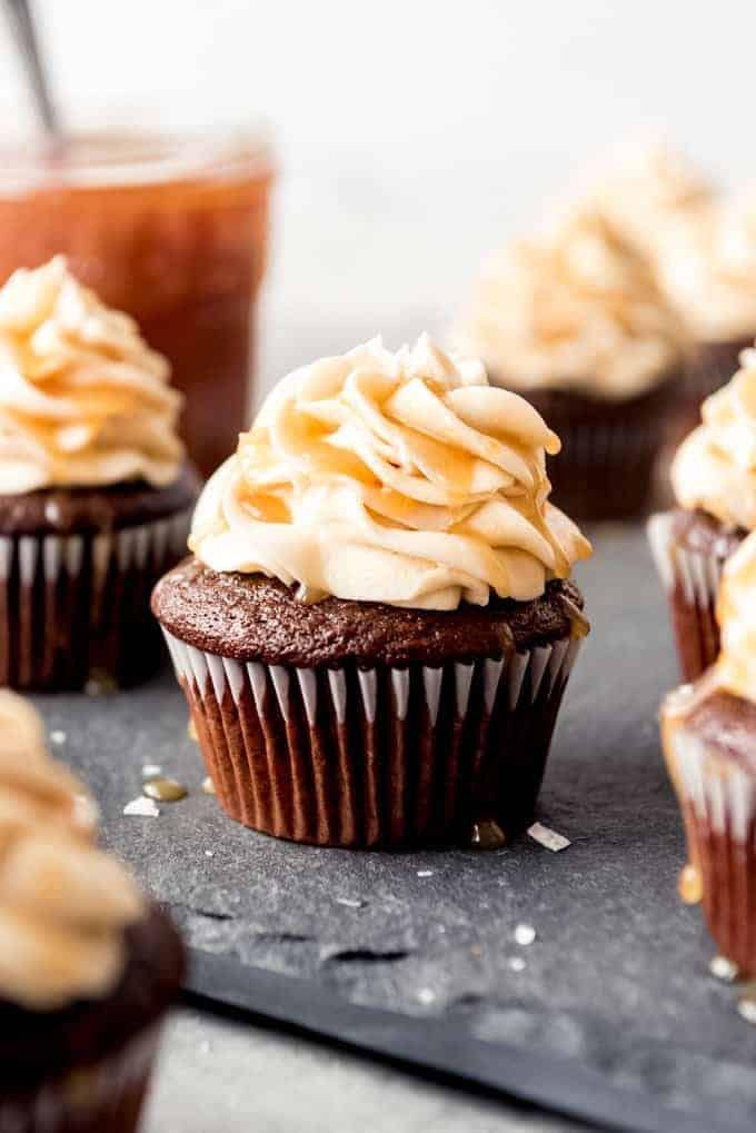 An image of a chocolate cupcake with salted caramel frosting on top.