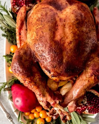 An image of a nicely browned whole Thanksgiving turkey on a serving platter.