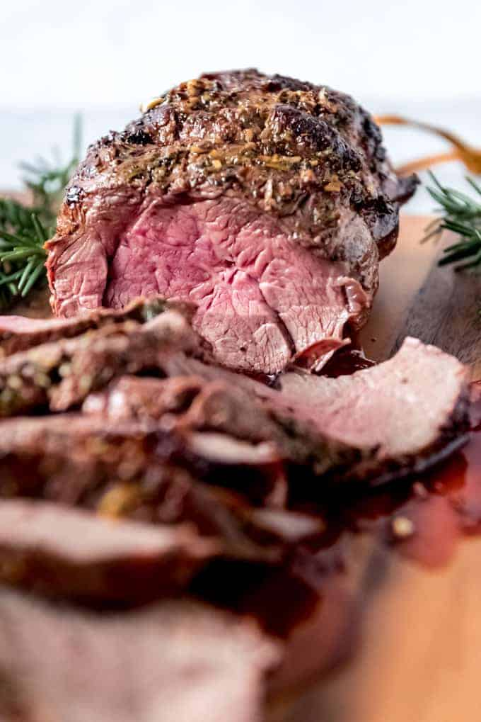 An image of the rosy pink center of a medium cooked beef tenderloin roast.