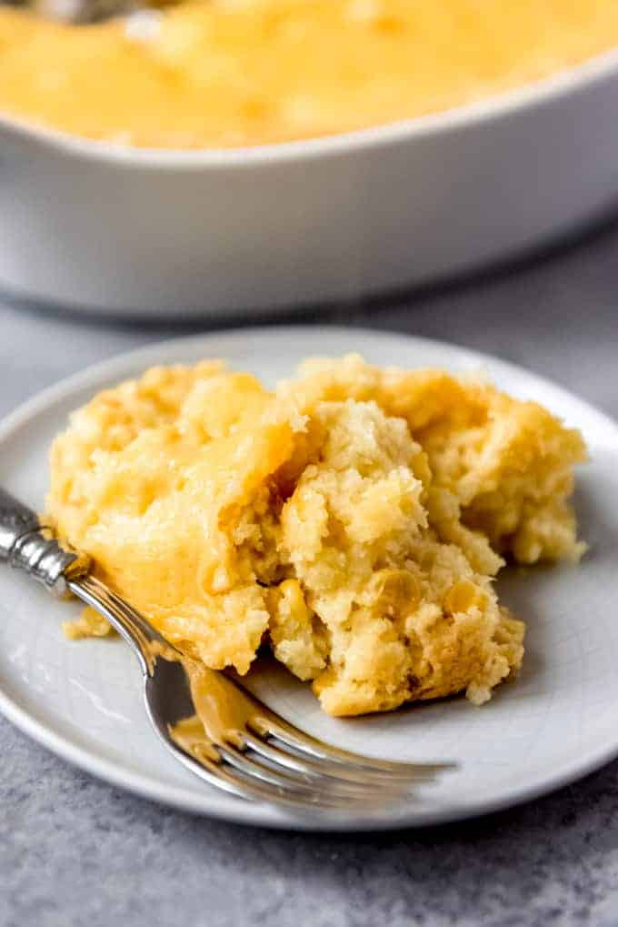 An image of a large scoop of corn casserole on a plate.