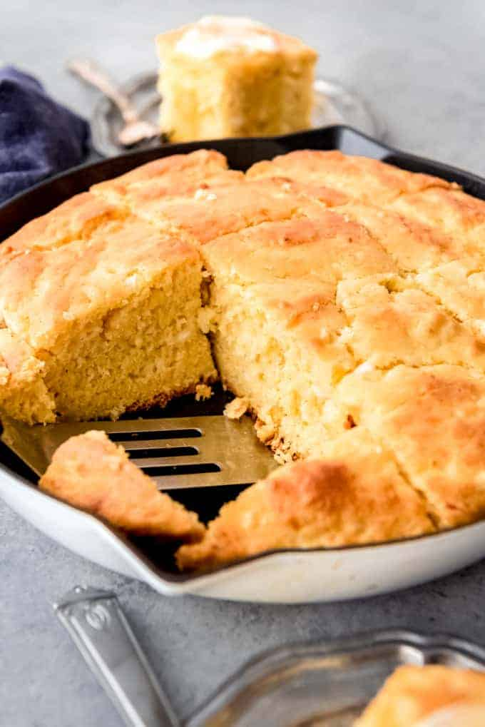 An image of cottage cheese cornbread in a cast iron skillet.