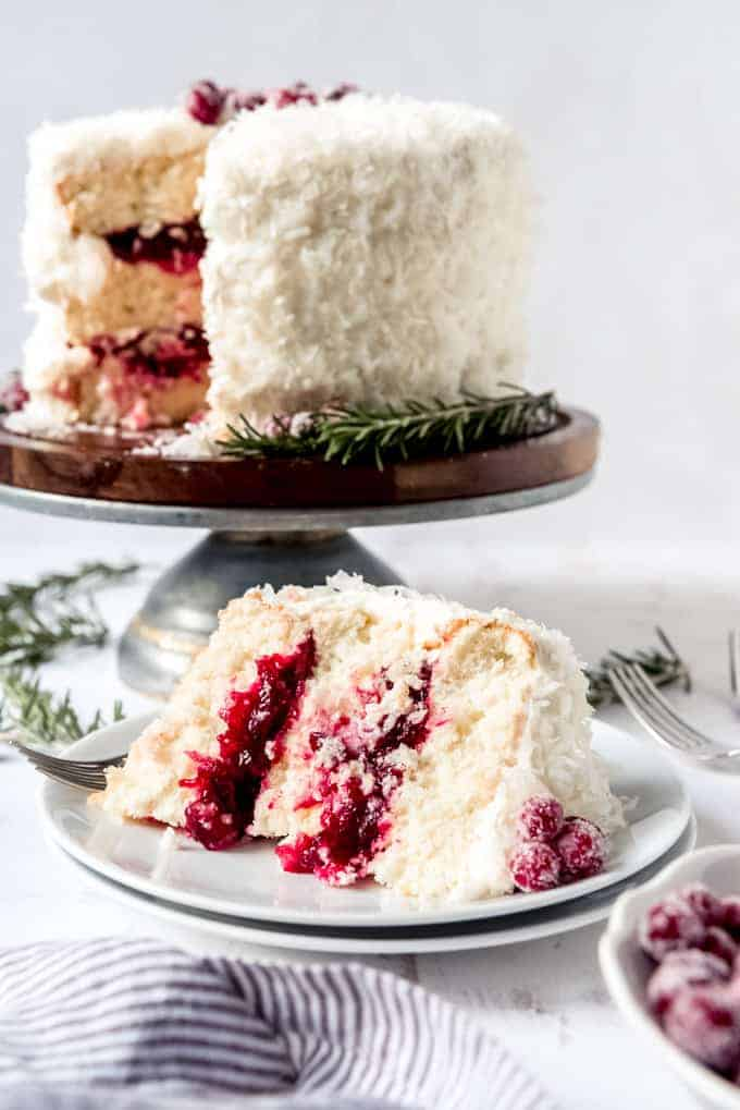 An image of a slice of festive Christmas cranberry coconut cake.