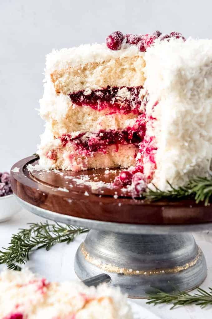 An image of a coconut cake filled with cranberry filling.