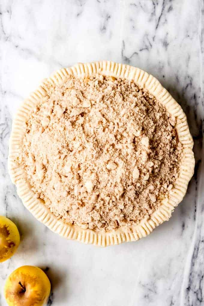 An image of an unbaked dutch apple pie.