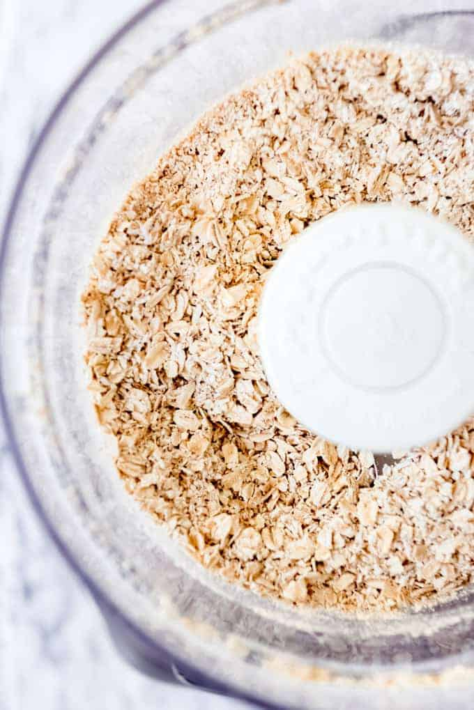 An image of oats that have been chopped in a food processor.