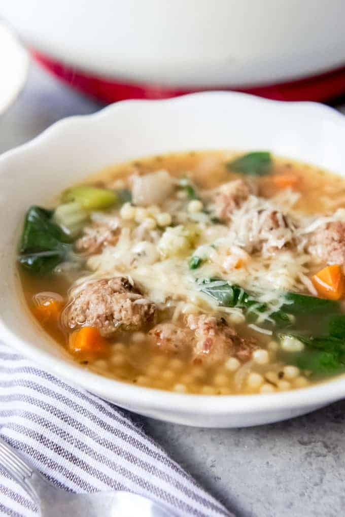An image of a bowl of Italian Wedding Soup with homemade meatballs.