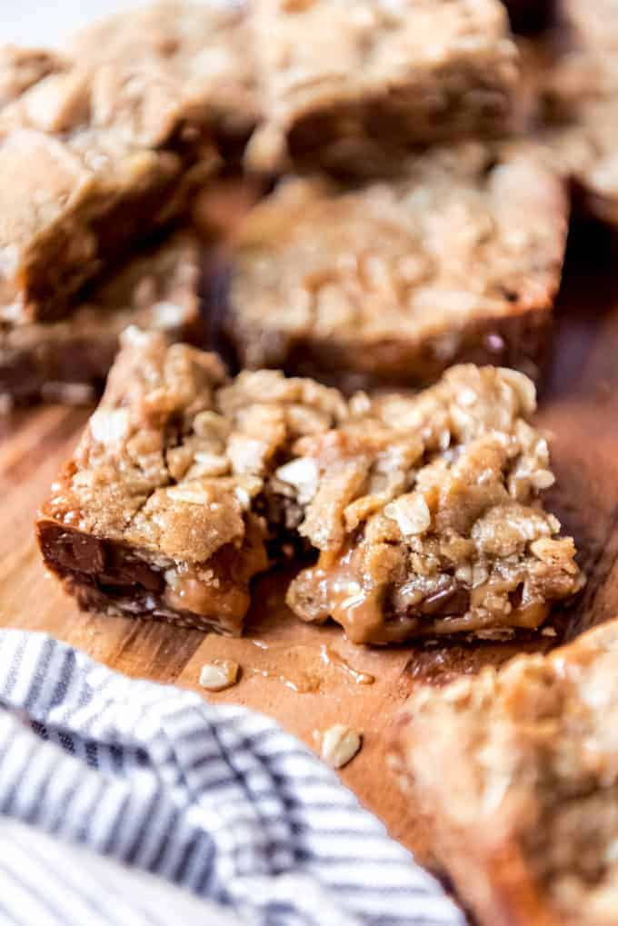 An image of gooey carmelita chocolate, oats, and caramel bars.