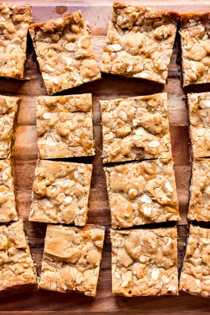 An image of oat and caramel bars cut into squares.