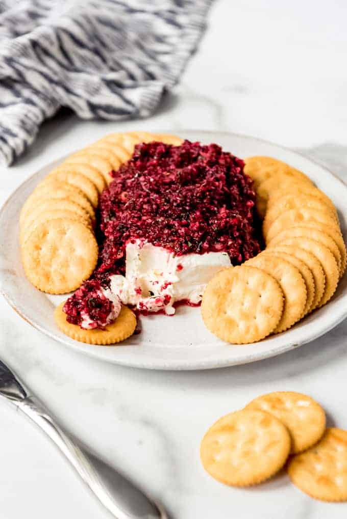 An image of fresh cranberry salsa served with cream cheese and Ritz crackers.