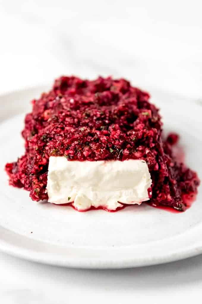 An image of cranberry salsa with cream cheese on a plate.