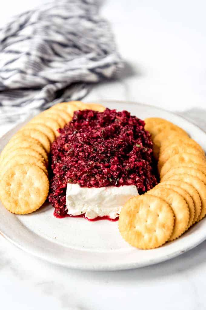 An image of an easy holiday appetizer of cranberry salsa served with cream cheese and crackers.