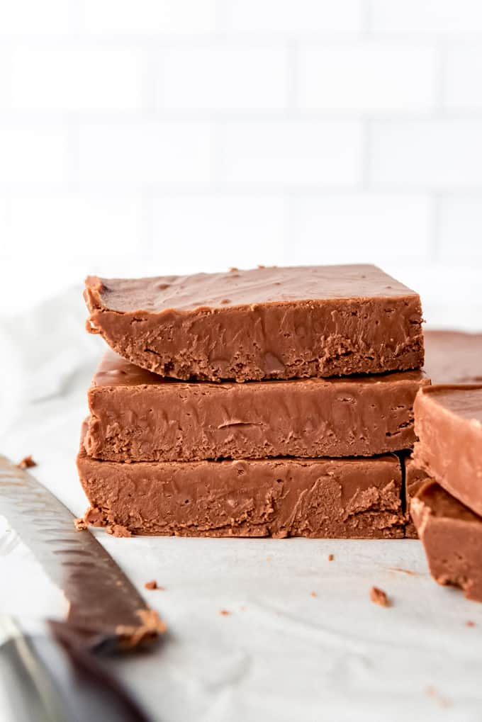 An image of an easy fudge recipe that has set and been cut into bricks to be stacked on top of each other.