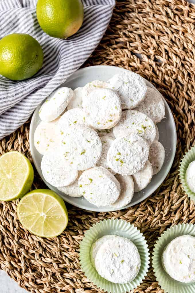 An image of lime meltaway cookies stacked on a plate.