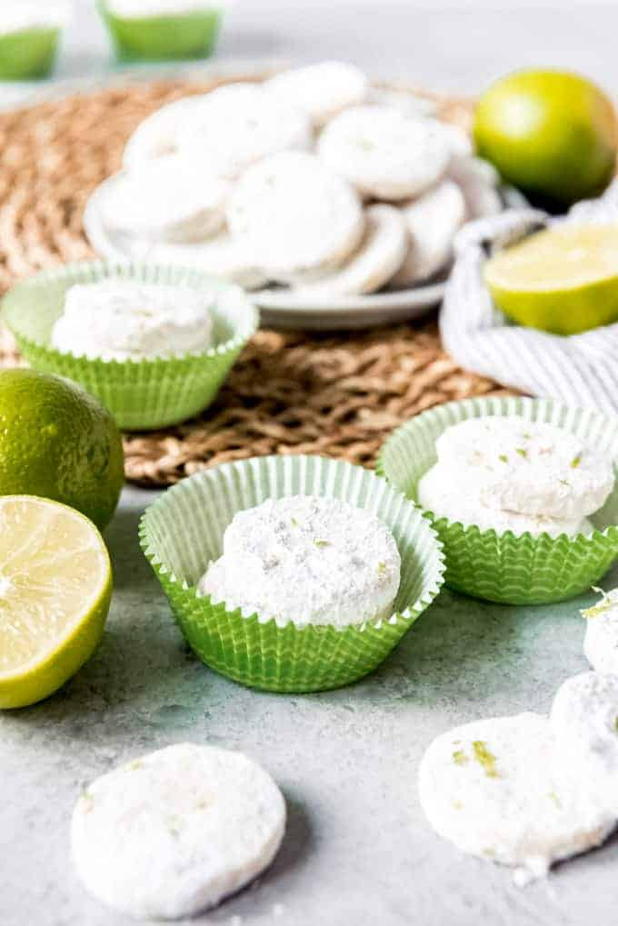 An image of bite-size lime meltaway cookies in green cupcake wrappers.