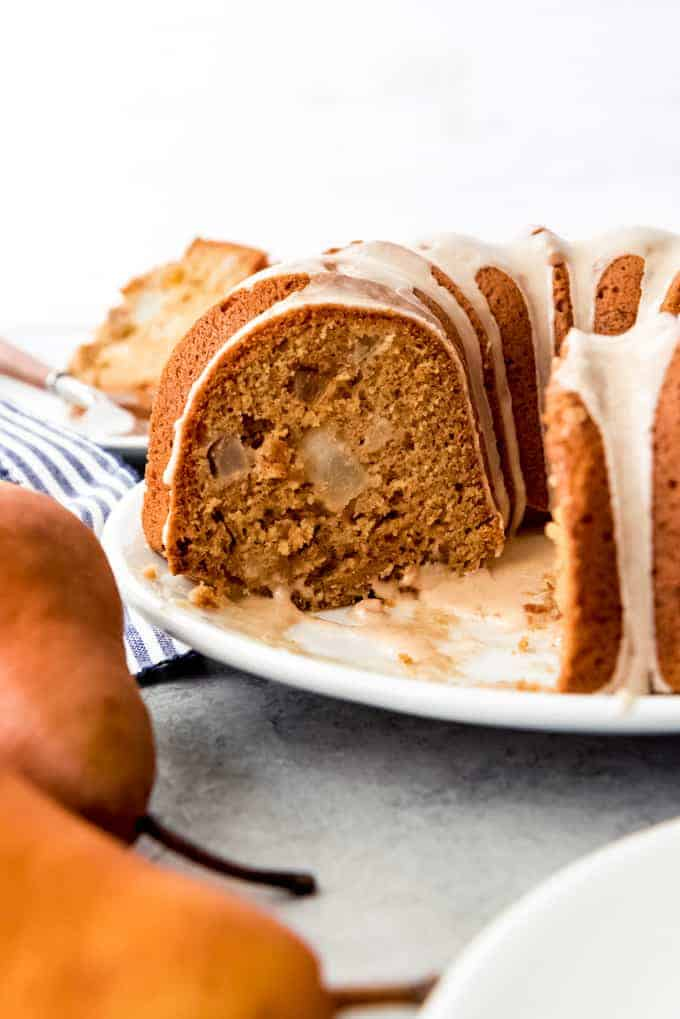 An image of a spiced bundt cake with pears and crystallized ginger.