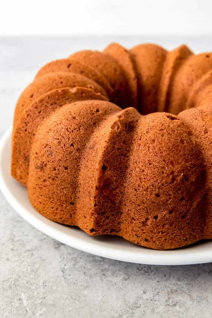 An image of an unglazed winter pear bundt cake on a white plate.