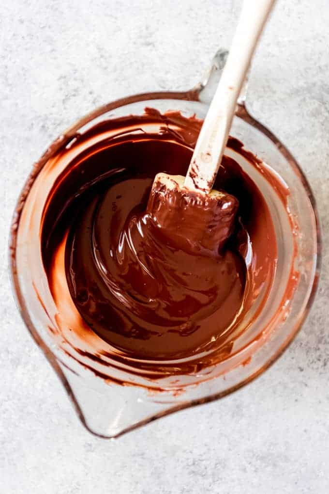 An image of melted dark chocolate in a glass bowl.