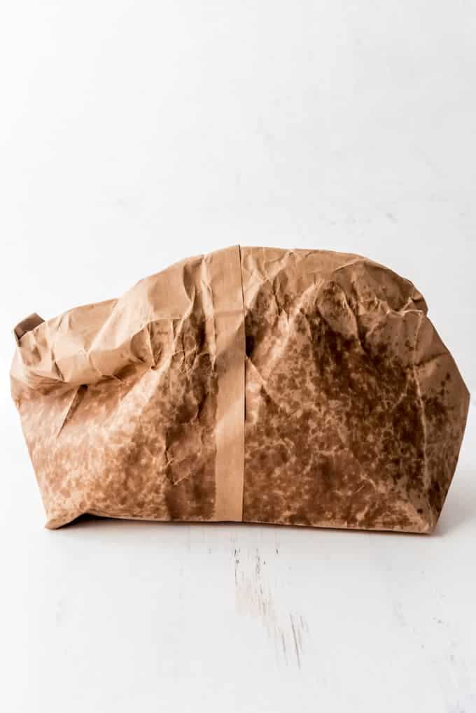 An image of a brown paper bag that has been used to cook popcorn in the microwave.
