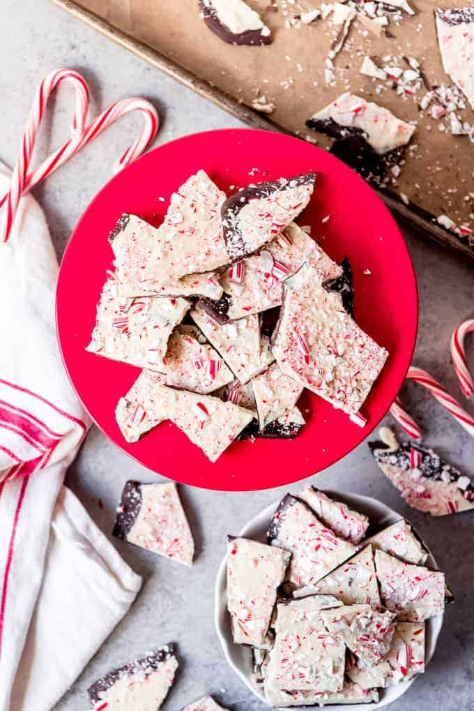 An image of candy cane peppermint bark on a red cake stand.
