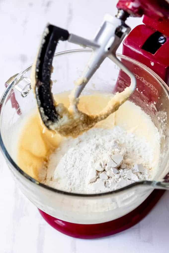 An image of sugar cookie dough in the bowl of a stand mixer.