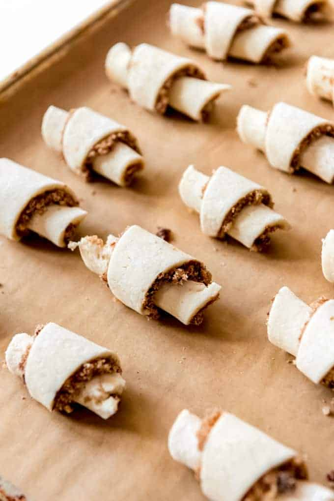 An image of rolled rugelach on a baking sheet ready to go in the oven.