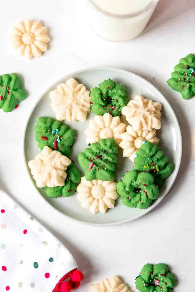 An image of spritz cookies on a plate.