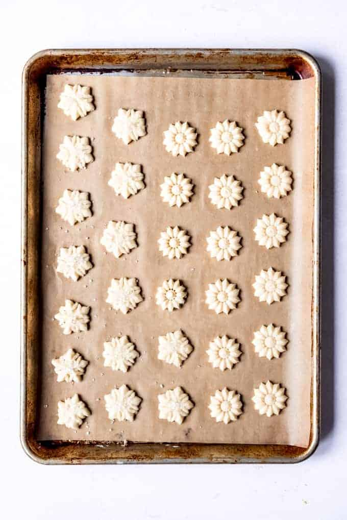 An image of Swedish butter cookies on a baking sheet.