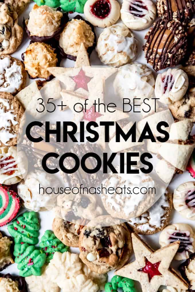An image of a dozen different types of Christmas cookies arranged together on a marble slab.