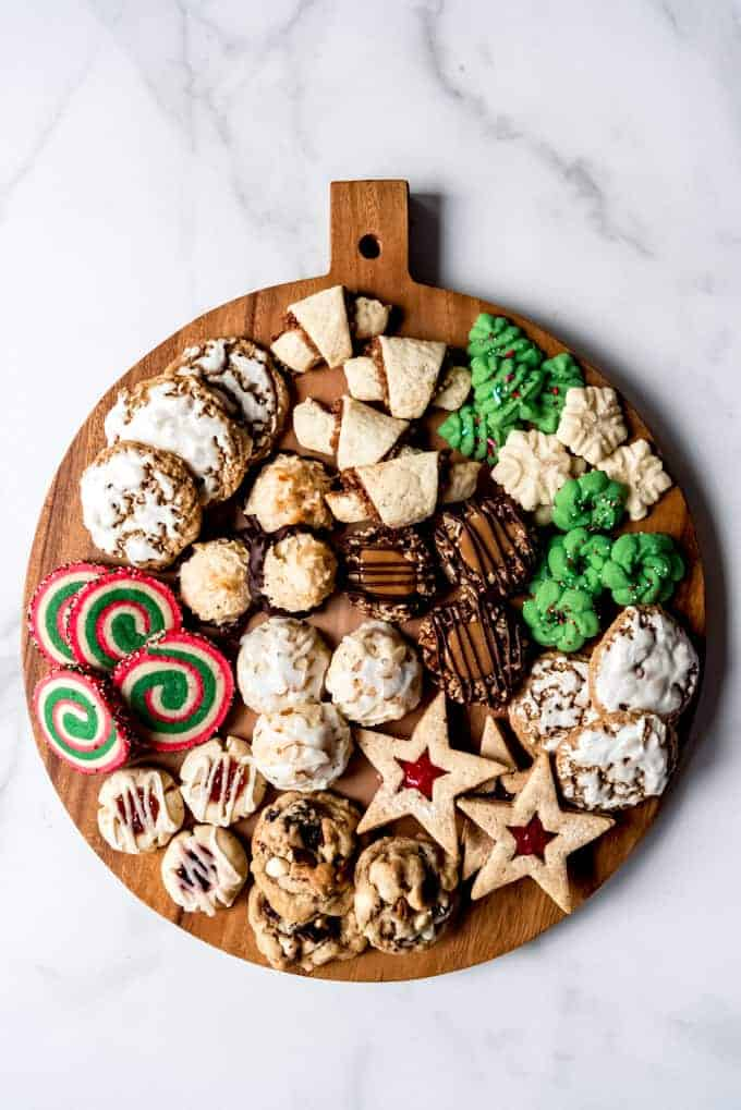 An image of some of the best Christmas cookies on a round cutting board.