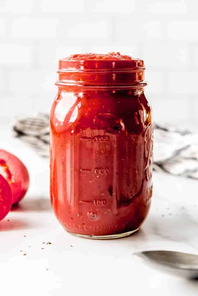 An image of a jar of homemade pizza sauce.