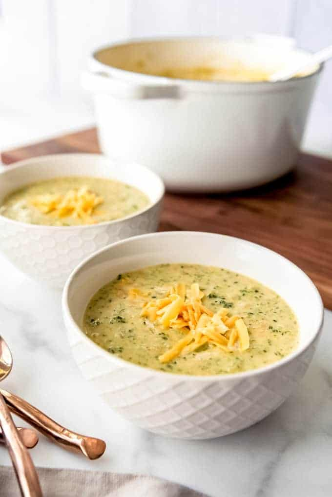 An image of a bowl of broccoli cheddar soup with extra cheese sprinkled on top.