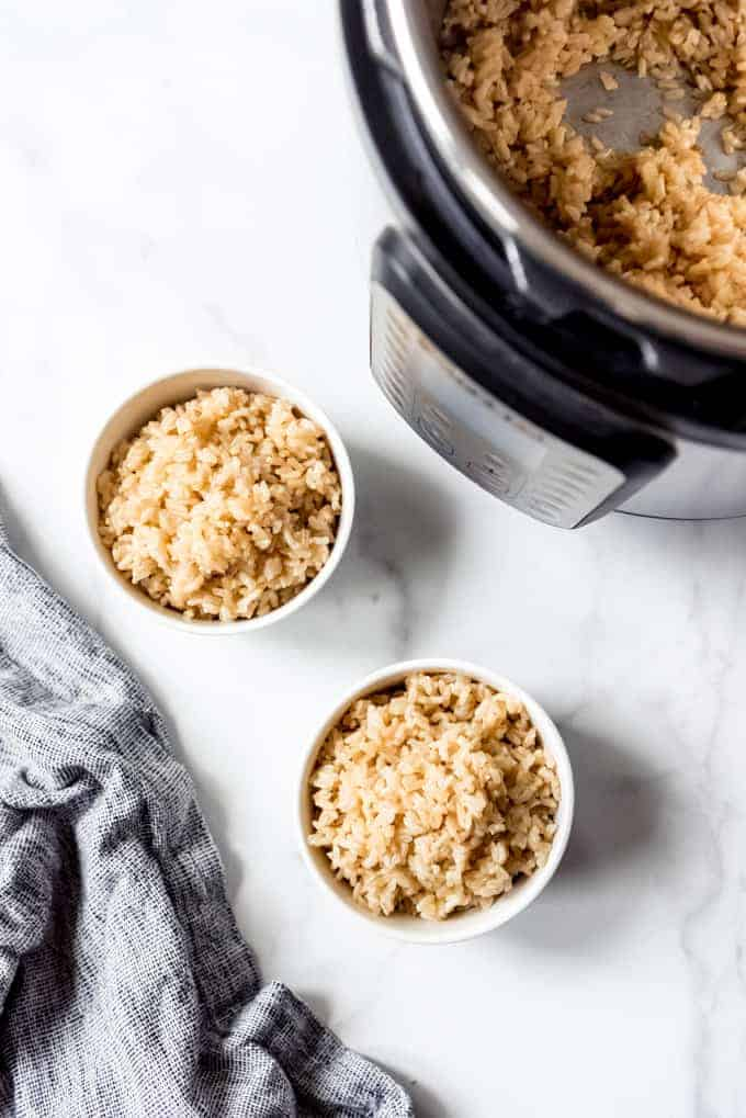 An image of bowls of fluffy pressure cooker brown rice.