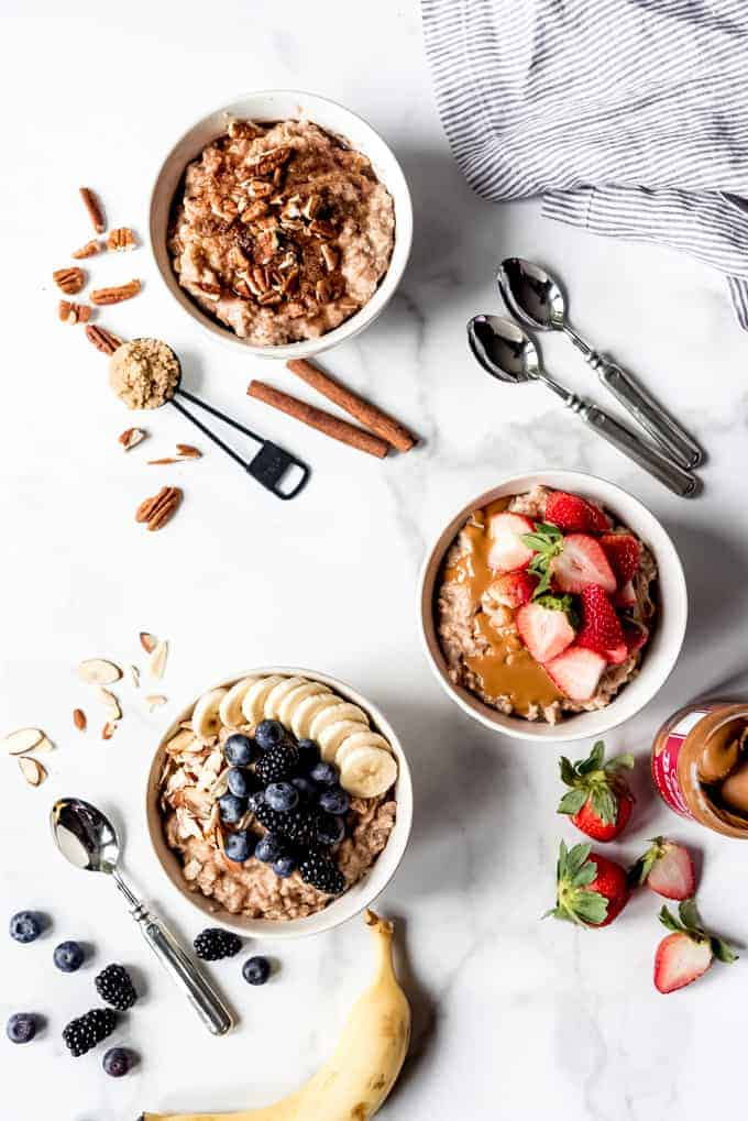 An image of three bowls of oatmeal with different toppings.