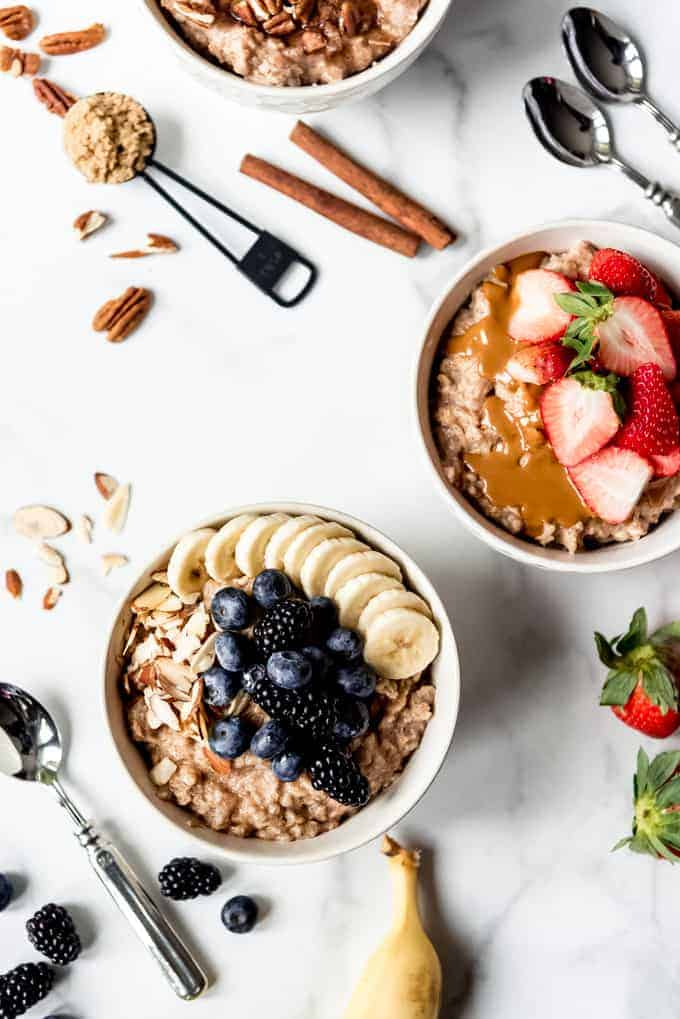 An image of bowls of oatmeal topped with fresh fruit.