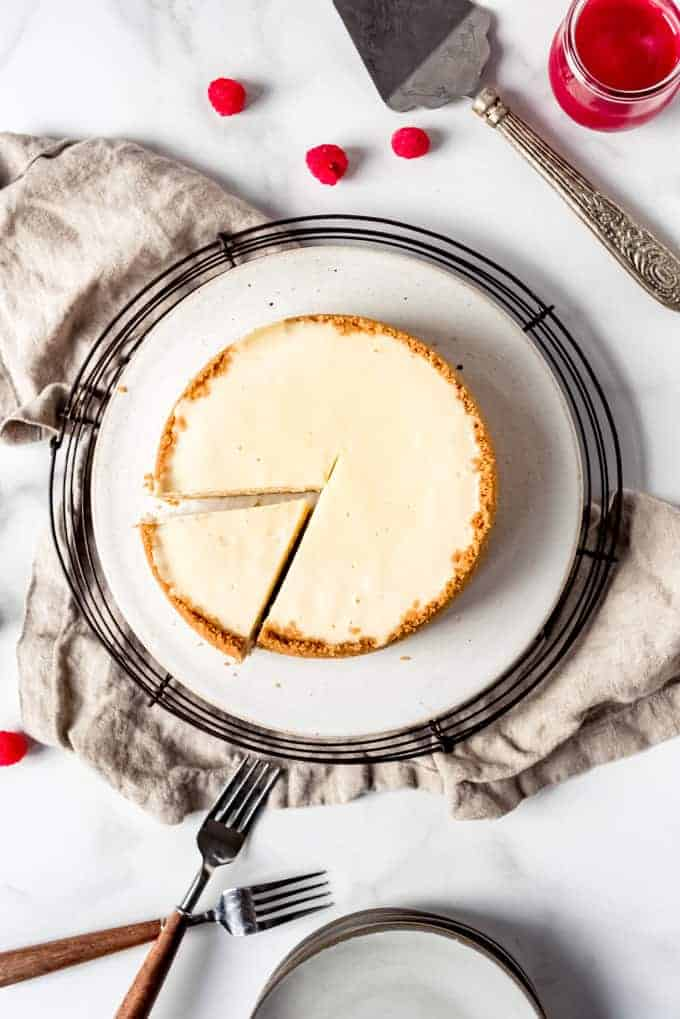 An image of a cheesecake with a slice cut out of it.