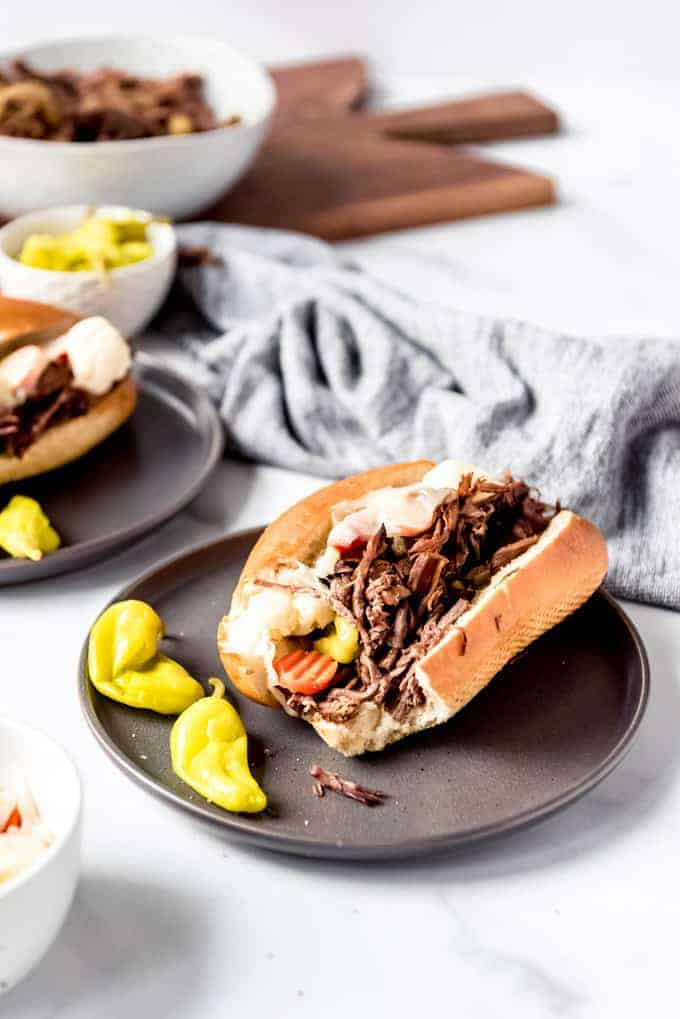 An image of an Italian beef sandwich with a bite taken out of it.