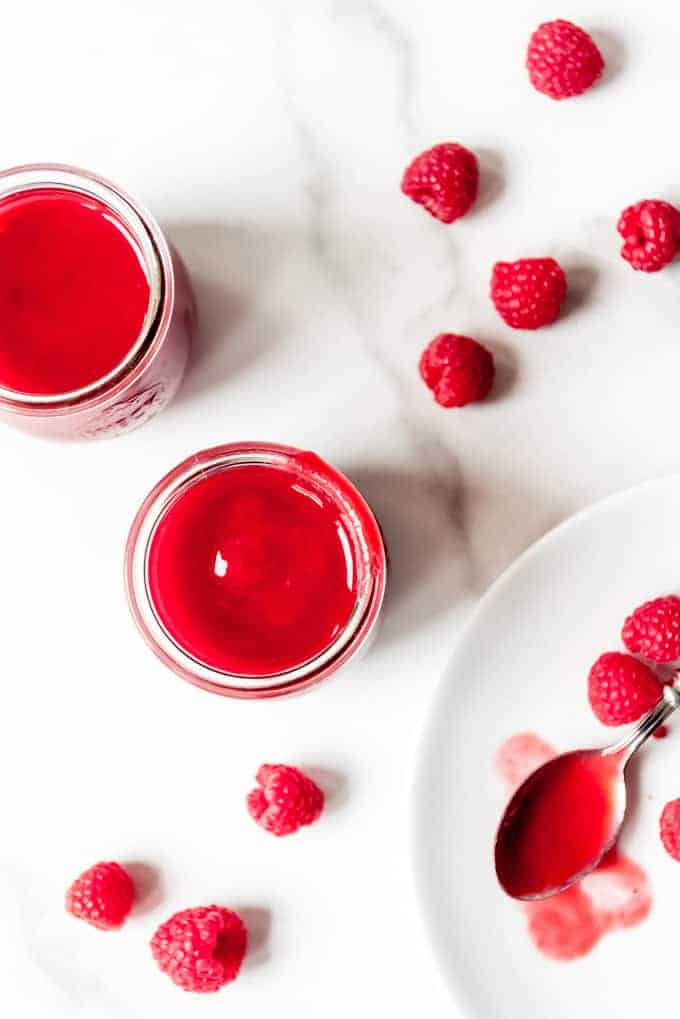 An image of a bright red fresh raspberry coulis for pouring over desserts.