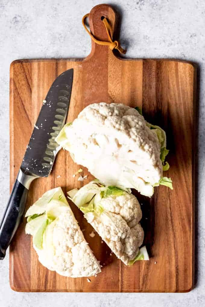 An image showing how to cut a head of cauliflower.