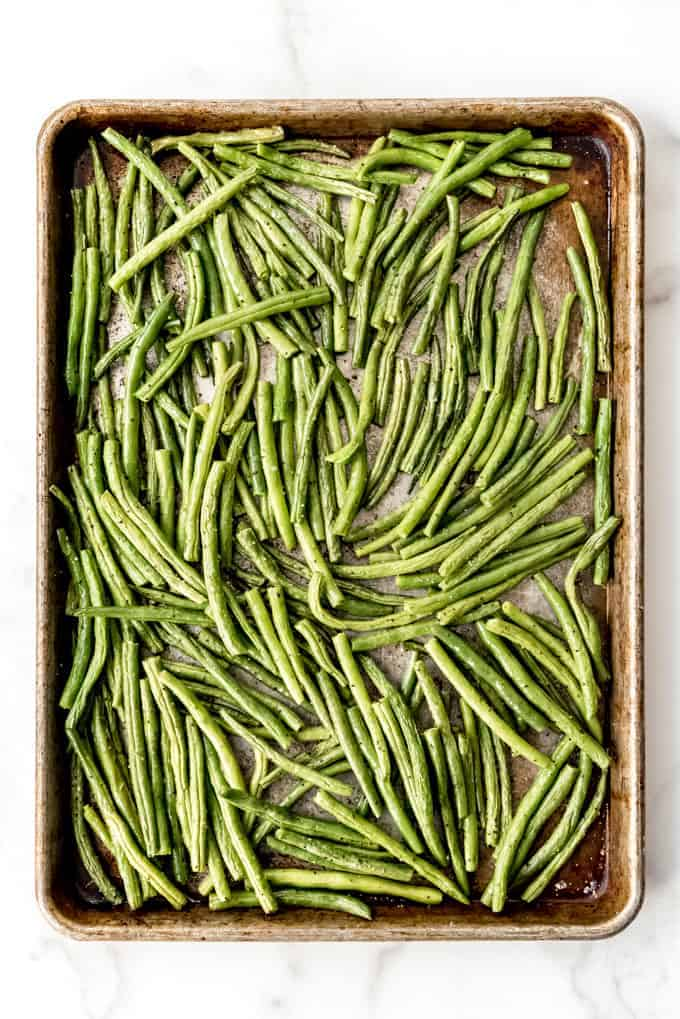 An image of simply seasoned roasted green beans on a baking sheet.