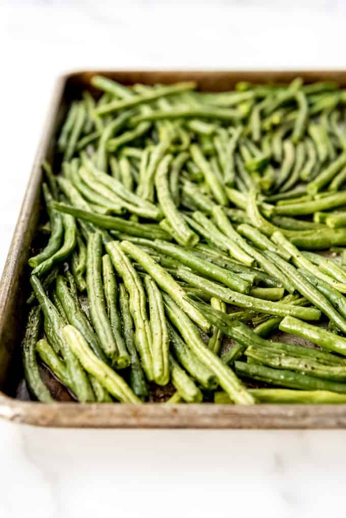 An image of roasted green beans on a baking sheet.