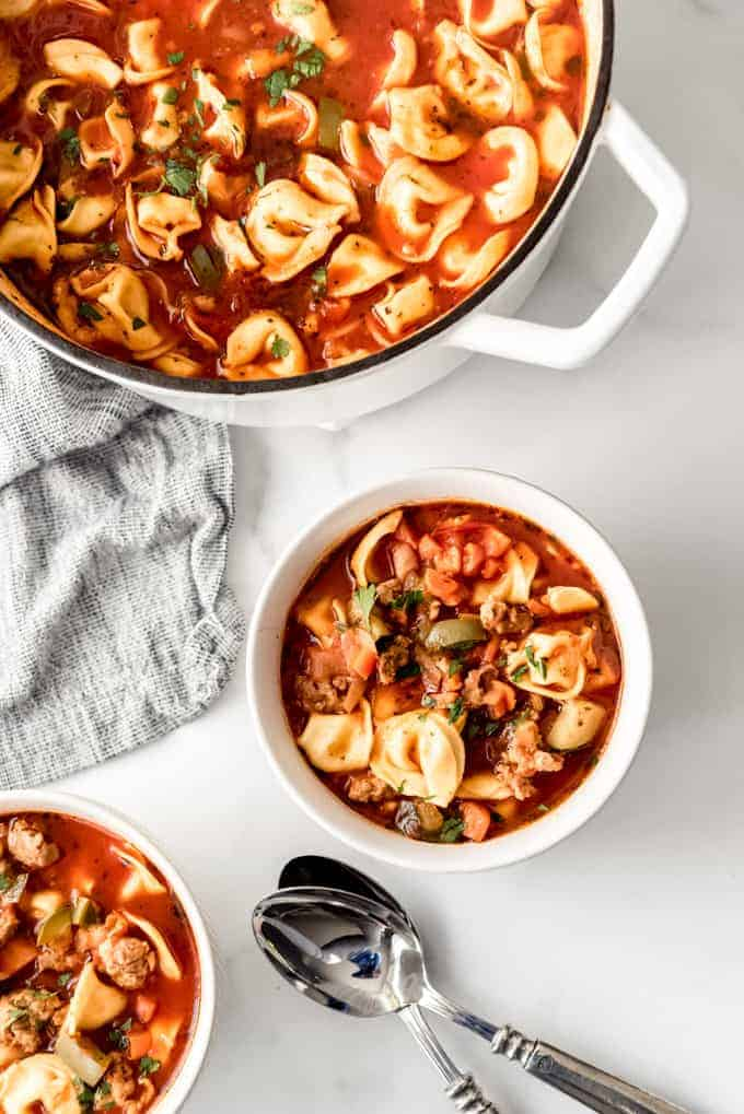 An image of a pot of homemade tortellini soup with sausage.