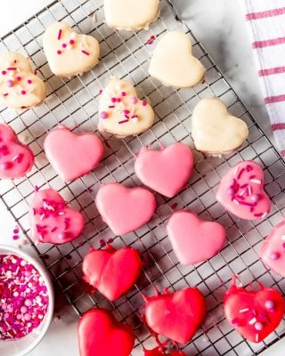 An image of red, white, and pink heart-shaped petit fours.