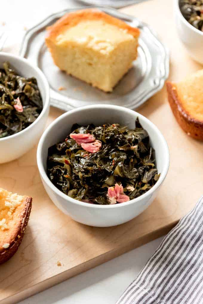 An image of tender, simmered greens served with cornbread.